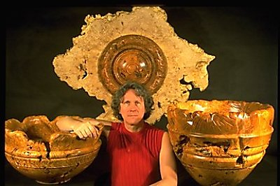 Dennis Elliott with Sculpted Vessels, turned, carved & burned Bigleaf Maple Burl